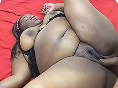 Niki Starr jumps up on top of his dick and rocks her fat black body back and forth to cum