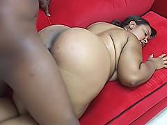 Hungry black BBW fits a big dick in her mouth before fitting it inside of her wet snatch