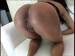 Ebony bitch is playing with her kitty on the sofa